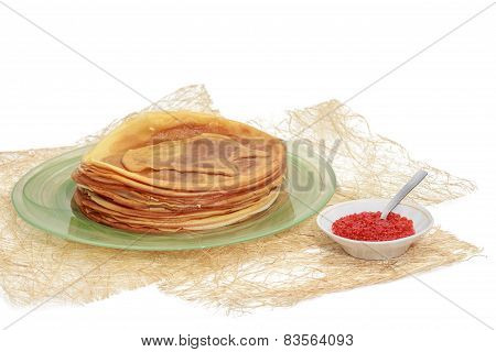 Pancakes With Red Caviar On A Plate And A Substrate Made Of Straw.