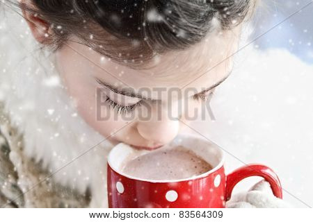 Young Girl Drinking Hot Chocolate Outdoor