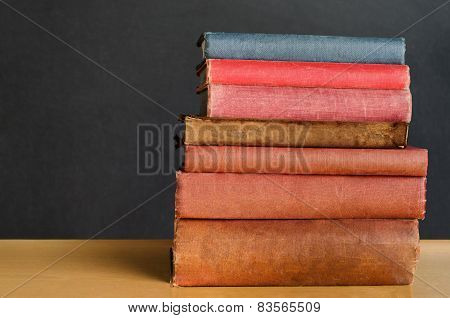 Books Stacked On Classroom Desk