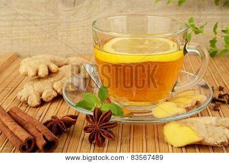 Ginger Tea-ingwertee On Wooden Mat With Lemon