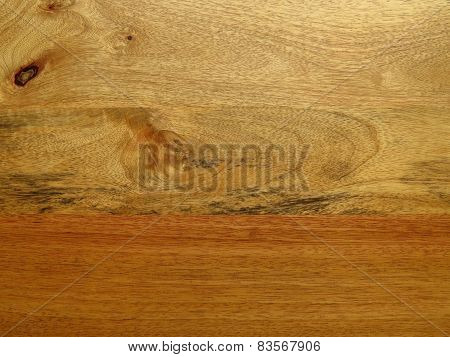 Mango wood grain resembling surreal landscape.