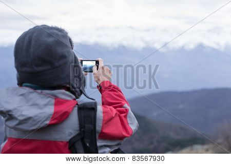 Hiker Taking Picture With Phone