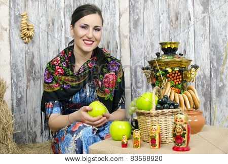 Brunette Sitting At The Samovar With Bagels