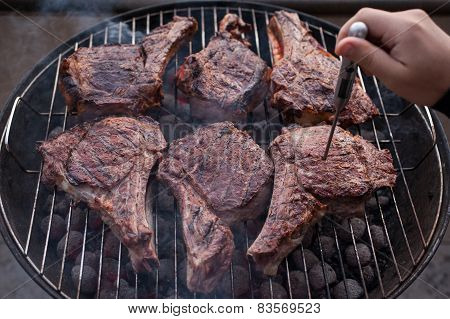Big Beef Steaks On Bone Grilled  Barbecue With Thermometer
