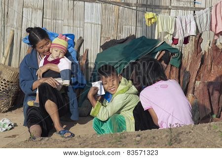 People of Lisu ethnic group sit in front of the house in Chiang Mai, Thailand.