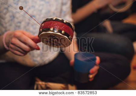 Women Playing Spin Drum No Face