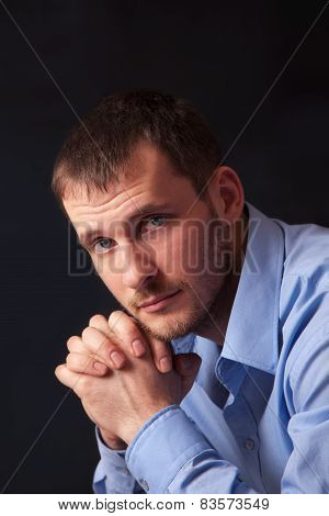 Fashion young man in blue shirt