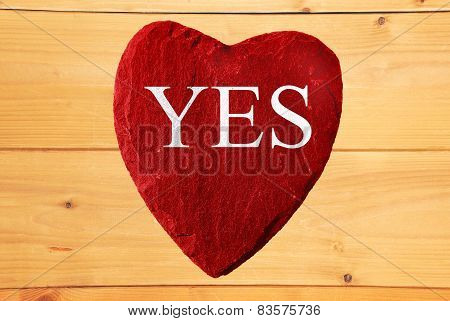 red heart with yes writing