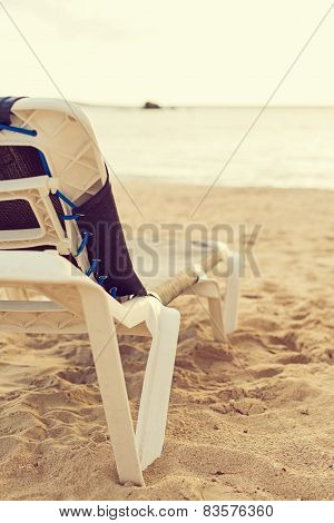 Empty Lounger On The Beach.