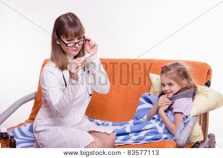 Pediatrician Checks Temperature On Electronic Thermometer Sick Child