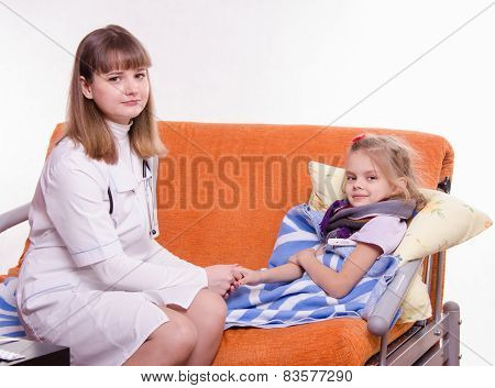 Doctor Holding A Sick Child's Hand