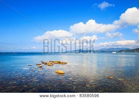 Rocks And Yachts In A Sea Bay. Punta Ala, Tuscany, Italy