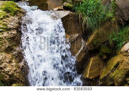 Small Waterfall In The Mountains
