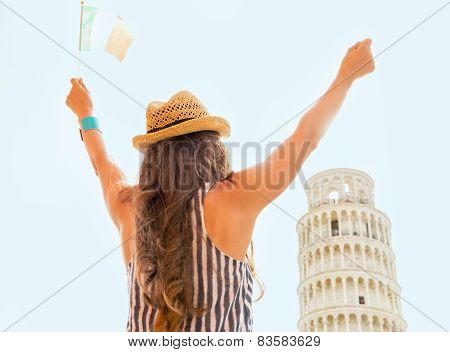 Young Woman With Italian Flag Rejoicing In Front Of Leaning Towe