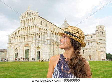 Portrait Of Happy Young Woman In Front Of Duomo Di Pisa, Pisa, Tuscany, Italy