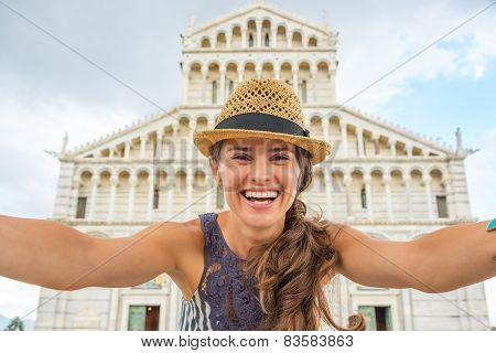 Happy Young Woman Making Selfie In Front Of Duomo Di Pisa, Pisa,