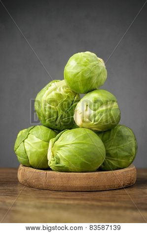 Fresh Brussels Sprouts On Wooden Table