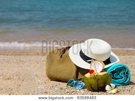 Straw Hat, Sunglasses, Beach Towel With Beach Bag And Coconut Cocktail