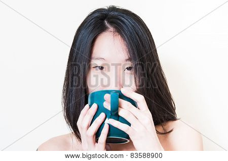 Young Asian Woman Closeup Drinking From Blue-green Cup