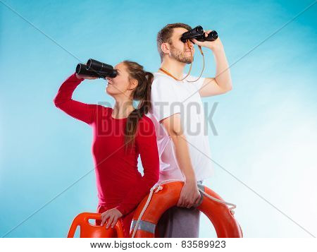 Lifeguards On Duty Looking Through Binoculars