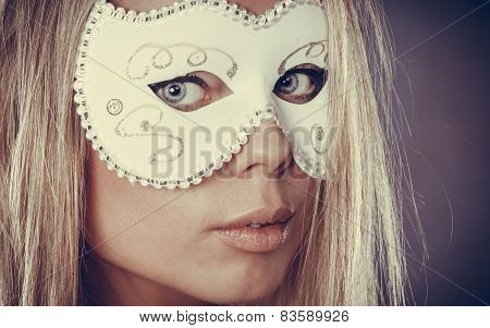 Closeup woman face caucasian blonde girl with white carnival mask