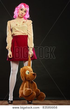 Childlike Woman And Big Dog Toy