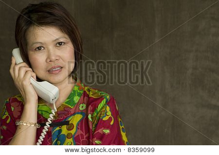 Asian Woman With Telephone