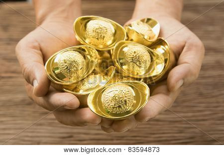 Hand Hold Chinese Gold Ingots