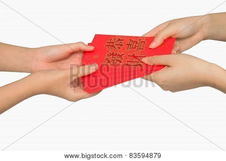 Hand Holding Ang Pow Or Red Packet Money Gift. Chinese New Year