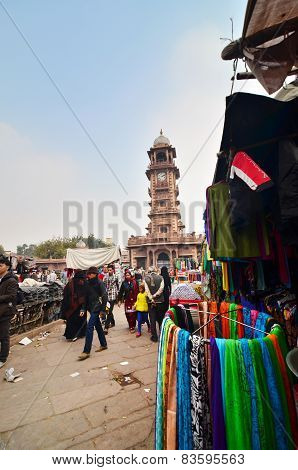 Jodphur, India - January 1, 2015: Unidentified People Shopping At Market Under The Clock Tower