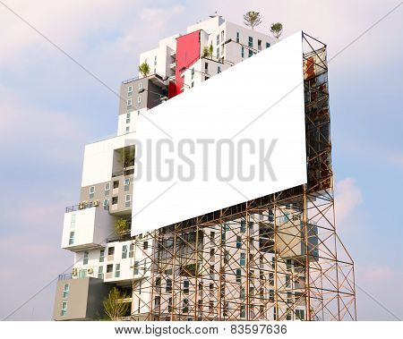 Large Blank Billboard On Road With City View Background