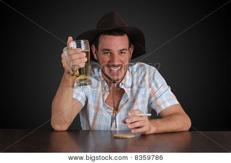 Cowboy having a beer