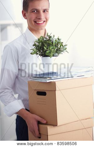 Portrait of a person with moving box and other stuff isolated on white