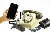 stock photo of telephone operator  - vintage picture style of New smart phone with old telephone on white background - JPG