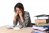 foto of overwhelming  - young stressed student girl studying pile of books on library desk preparing MBA test or exam in stress feeling tired and overwhelmed in youth education concept - JPG