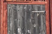 picture of red barn  - Grey Wooden Barn Door with a red barn - JPG