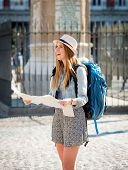 picture of visitation  - young happy attractive exchange student girl having fun in town visiting Madrid city reading tourist map having fun outdoors in tourism and travel vacation concept - JPG