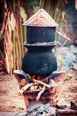 picture of boiling water  - Pot boiling water for cooking sticky rice on the fired stove - JPG