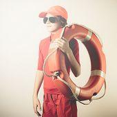 stock photo of lifeguard  - little boy lifeguard for summertime beach safety - JPG