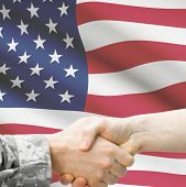 foto of soldier  - Soldier and doctor shaking hands with flag on background  - JPG