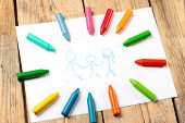 stock photo of montessori school  - Crayons lying on a paper with children - JPG
