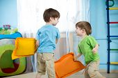 picture of pretty-boy  - Two children boys playing with pillows at home - JPG