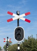 picture of railroad-sign  - railroad crossing sign with warning lights against a blue sky - JPG