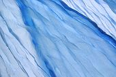 stock photo of twisty  - Abstract Blue Soft Chiffon Fabric Texture or Background Close - JPG