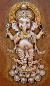 stock photo of ganapati  - The Indian God Ganesha made from clay in low relief carving - JPG
