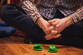 stock photo of castanets  - pair of green castanets in front men no face - JPG