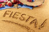 foto of mexican fiesta  - The word Fiesta written in sand on a Mexican beach with sombrero straw hat traditional serape blanket starfish and maracas - JPG