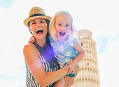 pic of mother baby nature  - Portrait of smiling mother and baby girl in front of leaning tower of pisa tuscany italy - JPG