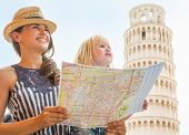 picture of mother baby nature  - Happy mother and baby girl with map looking into distance in front of leaning tower of pisa tuscany italy - JPG