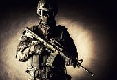 stock photo of anti-terrorism  - Spec ops police officer SWAT in black uniform and face mask - JPG